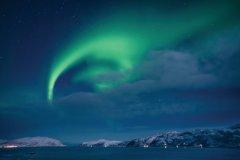 Aurores boréales sur le comté de Troms. (© Konrad Konieczny, Nordnorge)