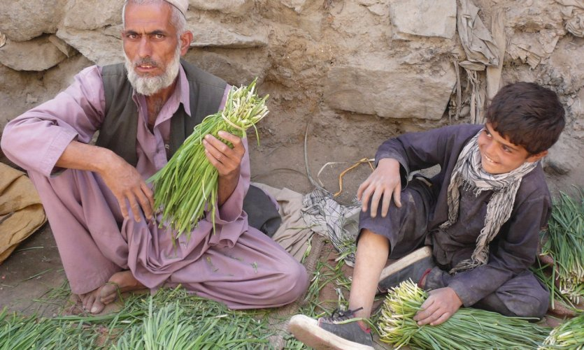 <p>A grandfather and his grandson at the bazaar.</p>