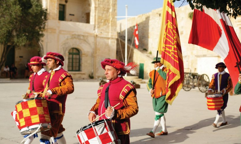Parade of Maltese knights on the streets of Valletta.