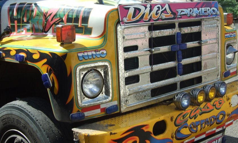 Details of a Diabolos Rojos, multi-coloured city bus, capital icon.