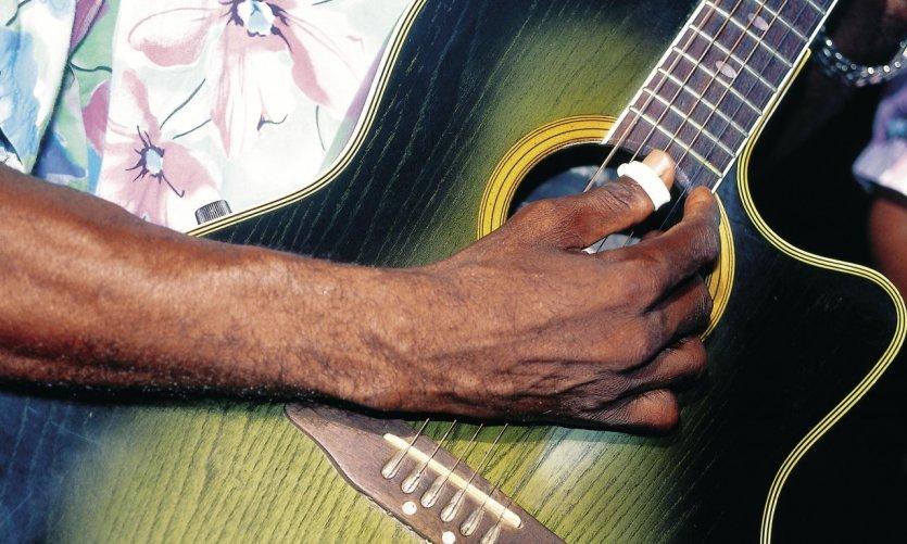 Guitariste sur la plage de Las Terrenas.