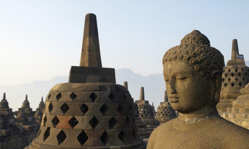 The temple of Borobudur, whose stûpas had long been abandoned.