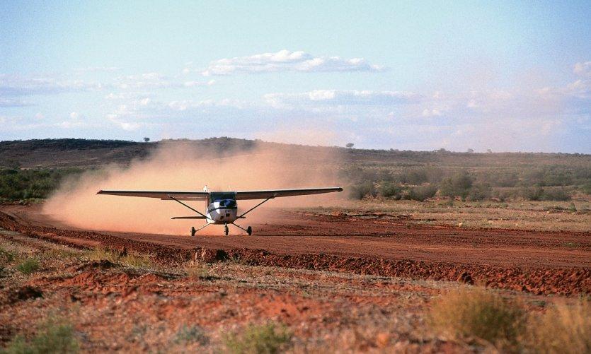 <p>A plane flies off a farm near Alice Springs.</p>