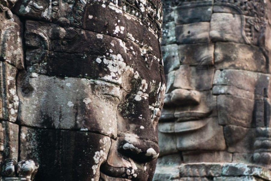 Têtes de Bouddha de pierre au Temple Bayon à Angkor. (© Jordan Banks))