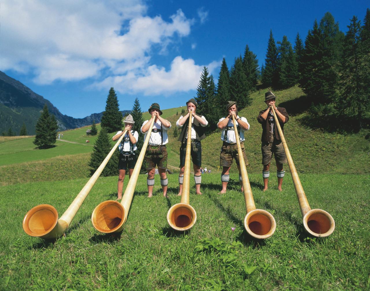 Tyrol musicians and their alphorn.