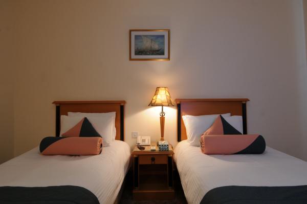 Twin Bed Room - ©FALAJ DARIS HOTEL